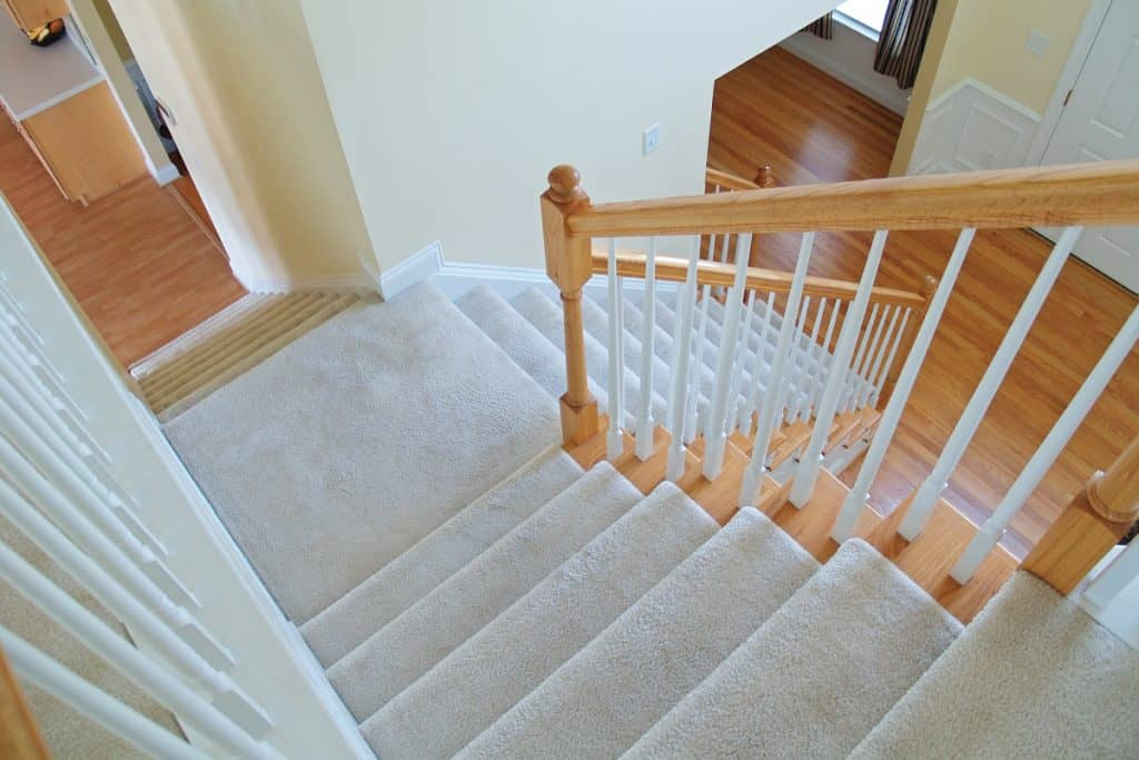 white carpeted stairway, How Long Does Carpet Last on Stairs