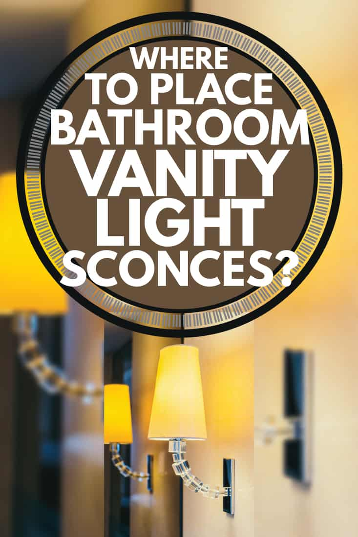 yellow sconce against a mirror wall, where to place bathroom vanity light sconces