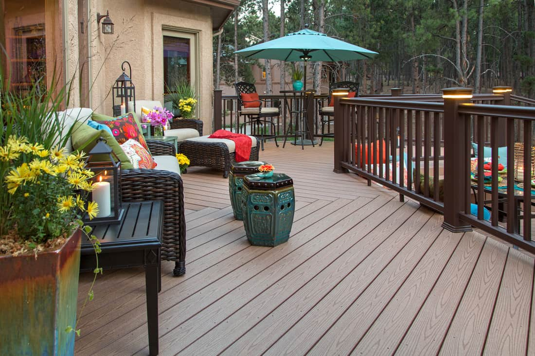 Beautiful backyard deck with built-in lighting Deck Post Lightsand fully decorated with vibrant and colorful furniture and decor