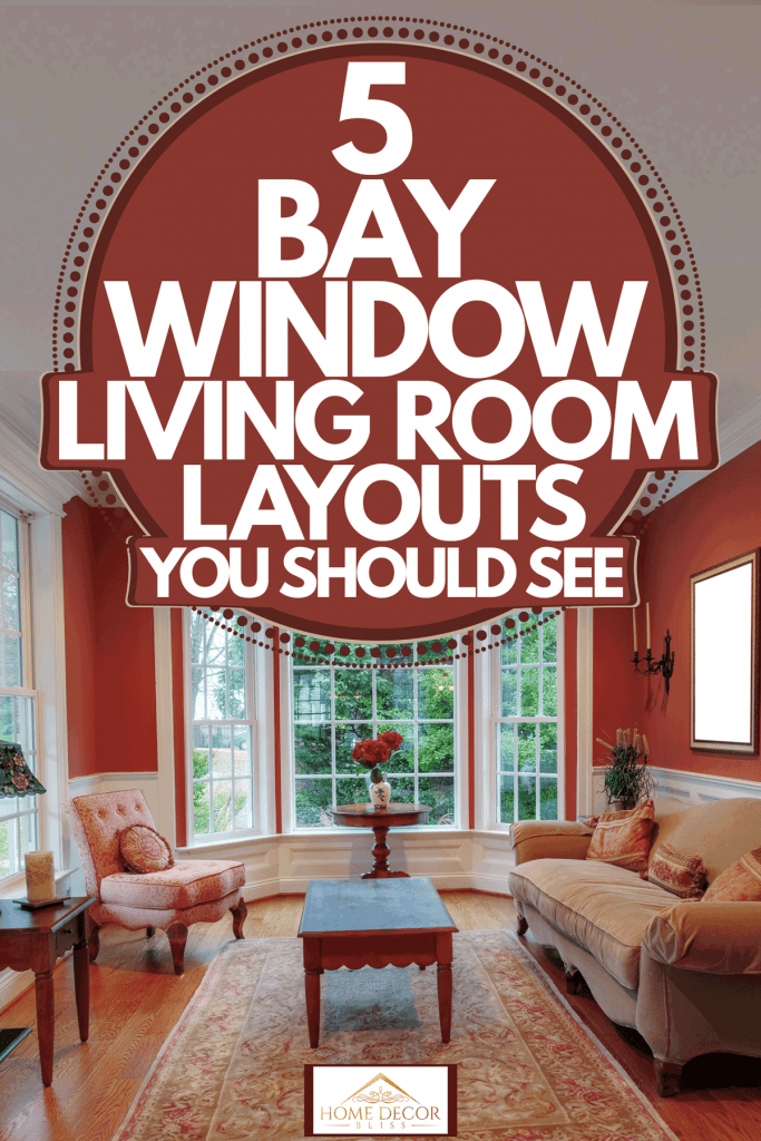 A narrow living room with hardwood flooring, maple painted walls, vintage styled sofa, and a bay window on the background, 5 Bay Window Living Room Layouts You Should See