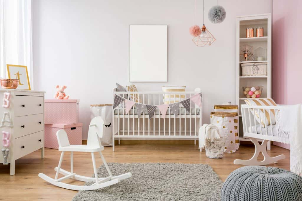 A children's room incorporated with pastel colors with other infant equipment