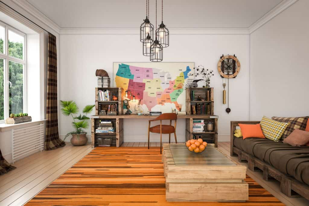 A farmhouse styled living room with a wooden textured rug and an industrial design chandelier