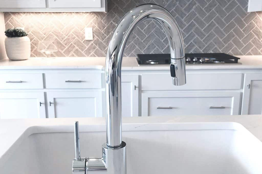 A luxurious faucet in a contemporary designed kitchen