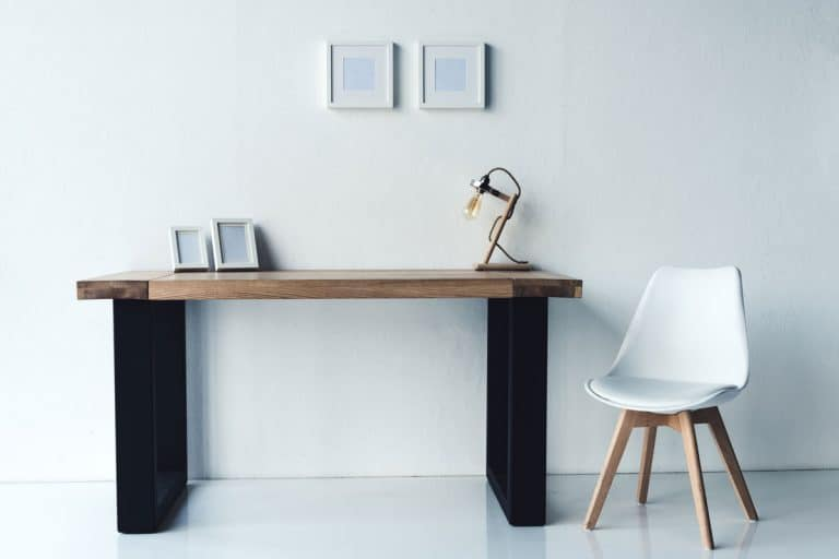 A modern console table with black metal framing and a wooden top inside a white contemporary living room, 8 Types of Console Tables