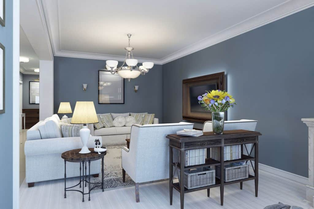 A modern living room with opaque colored sofas and dark blue painted wall