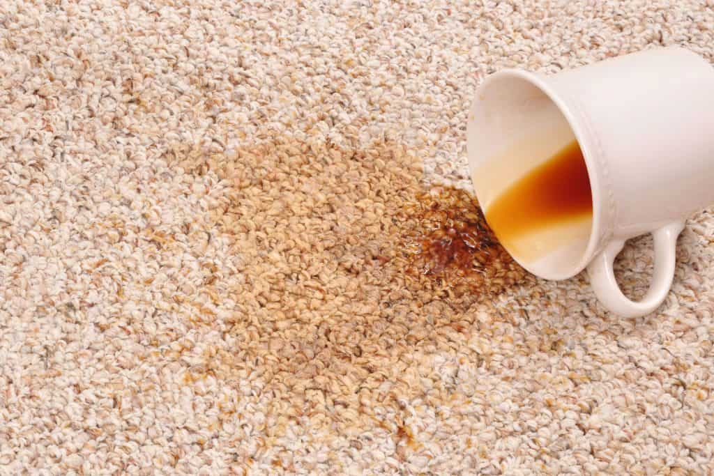 A mug of coffee spilled on the carpet