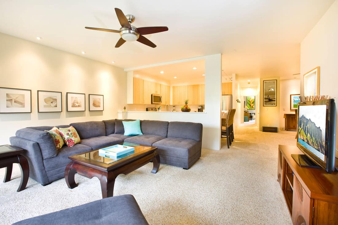 A tropical beach house themed contemporary apartment condominium interior design with sectional couch, How To Keep A Sectional Couch Together