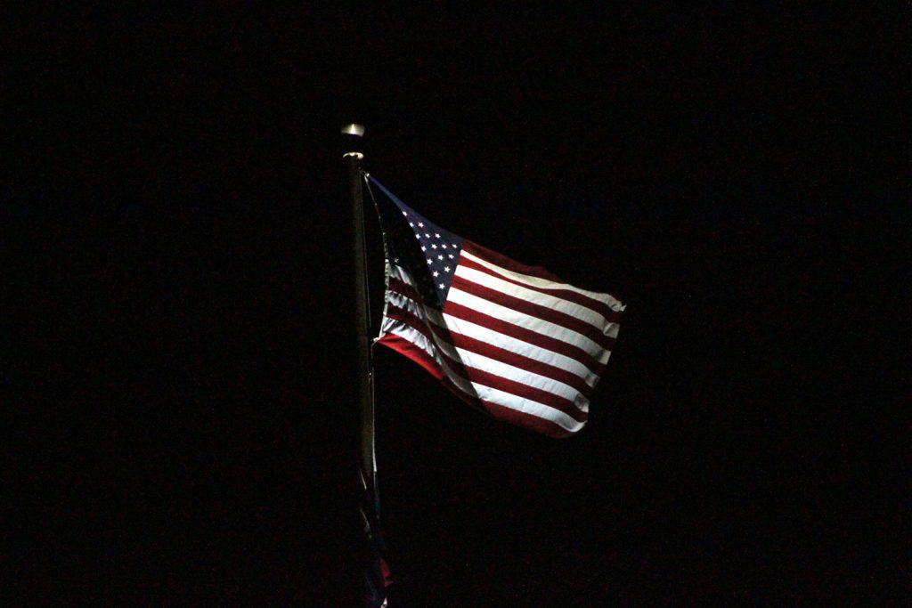 An American Flag isolated on a dark background