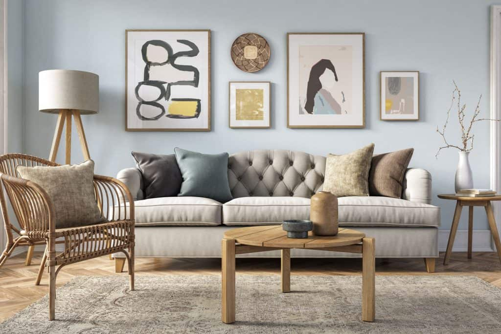 An interior of a modern bohemian themed house with wooden furniture and cream colored couch