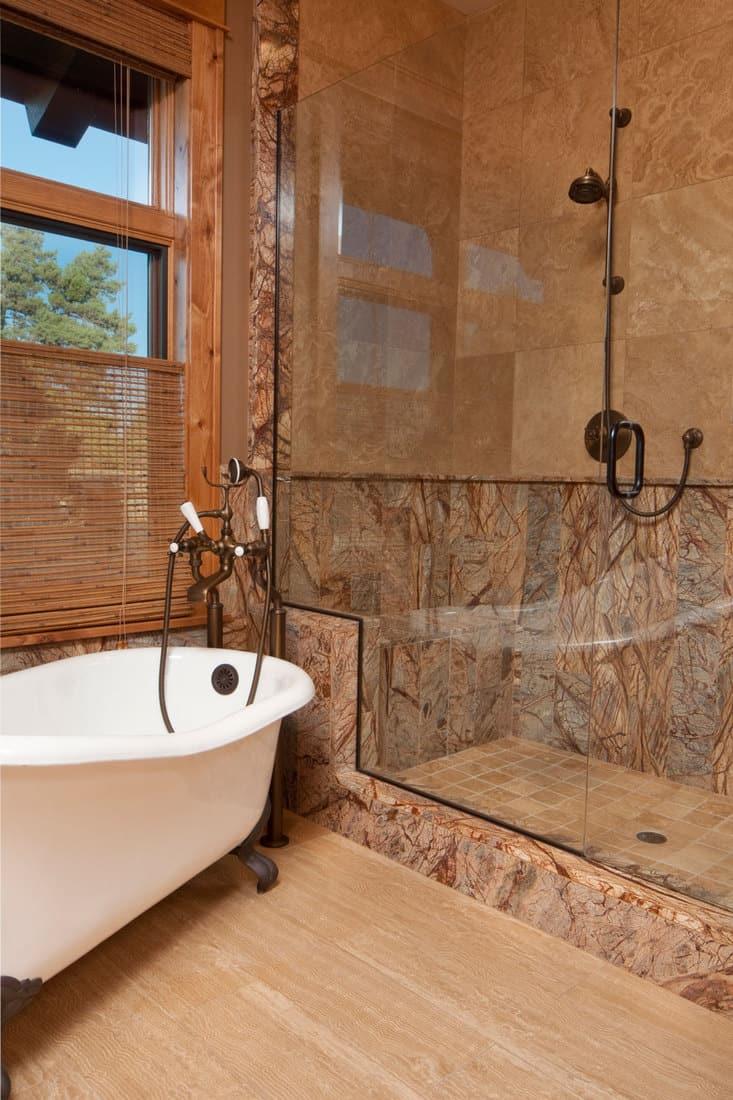 Bathroom with bathtub and showerhead