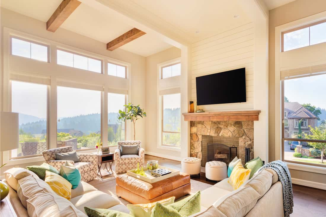Beautiful living room with hardwood floors, vaulted ceiling, tv and fireplace