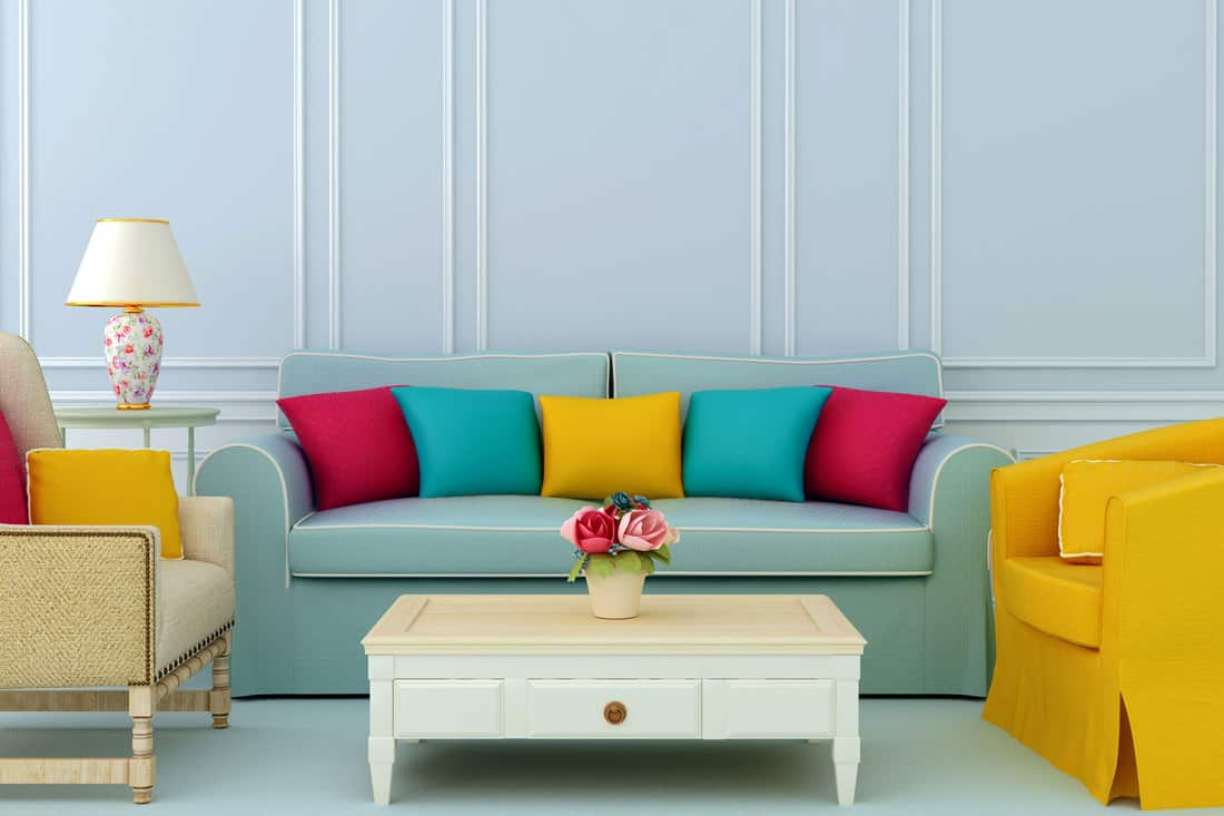 Composition with sofa and armchairs and colorful throw pillows