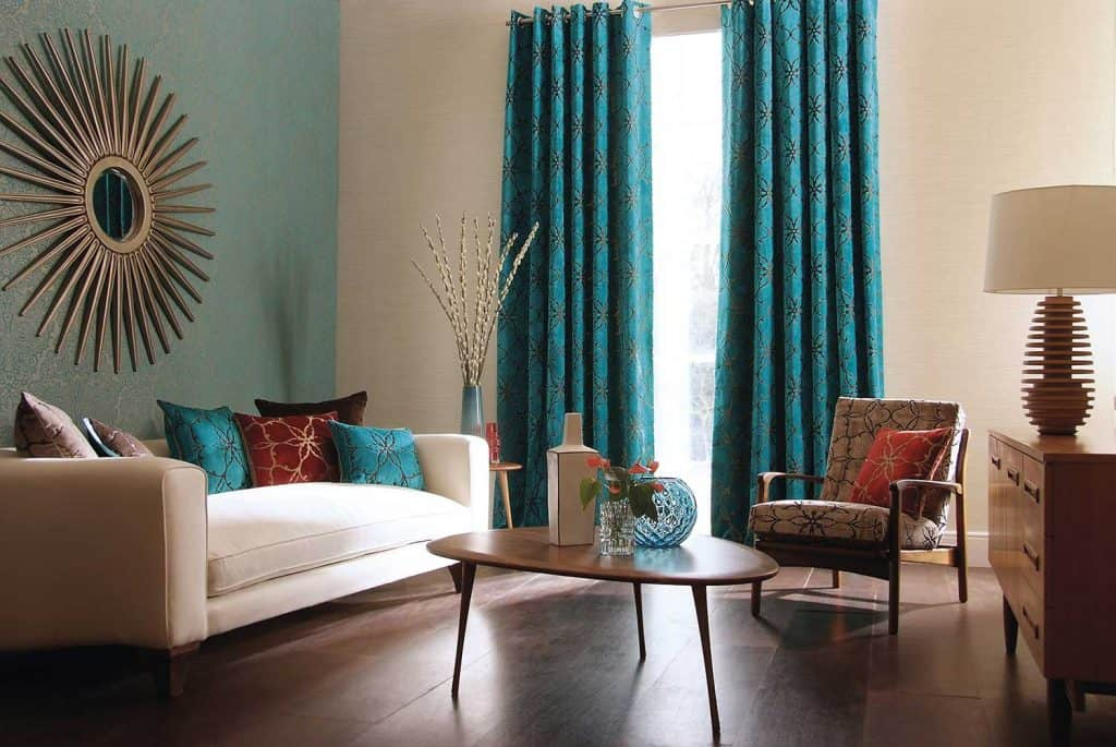 Contemporary living room with sofa, curtains, table and vases
