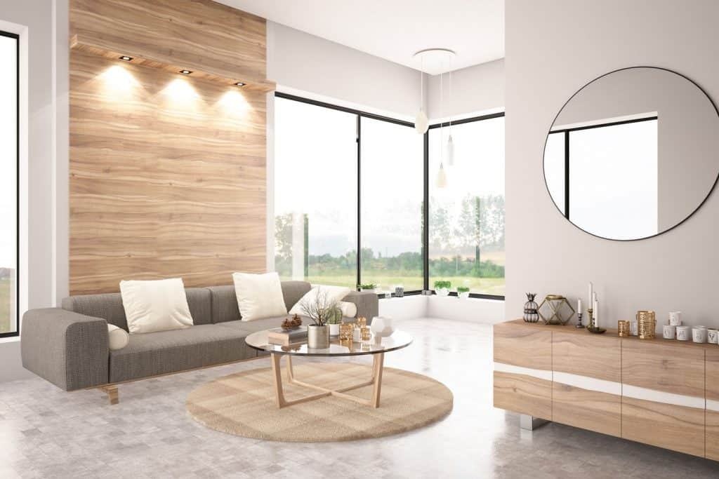 Contemporary modern house with huge windows, white painted walls, and a wooden paneled accent wall with wall lamps