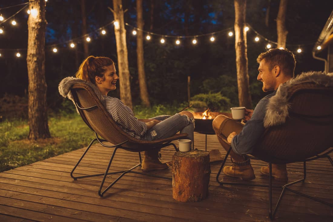 Couple on porch with string lights