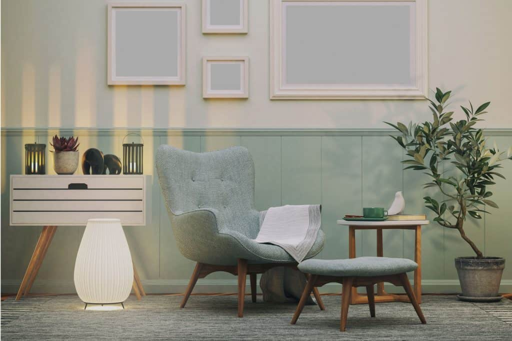 Eccentric teal and gray incorporated living room with and indoor plant on the side and picture frames hanged on the walls