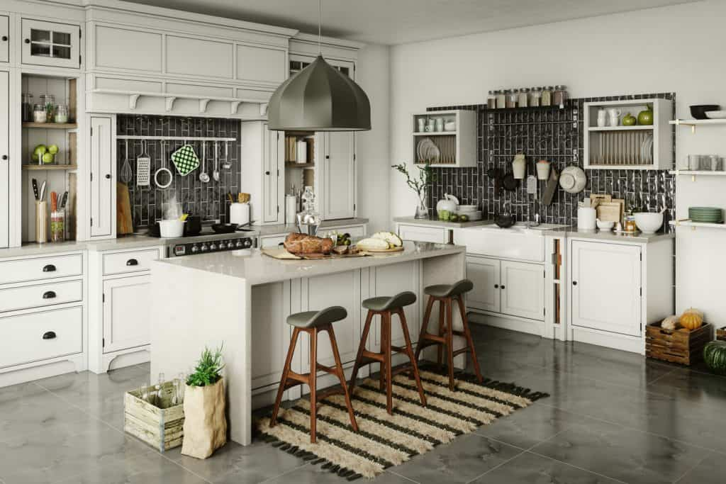 Farmhouse inspired kitchen with white paneled cabinets, kitchen utensils hanged on walls and dividers filled with herbs and spices