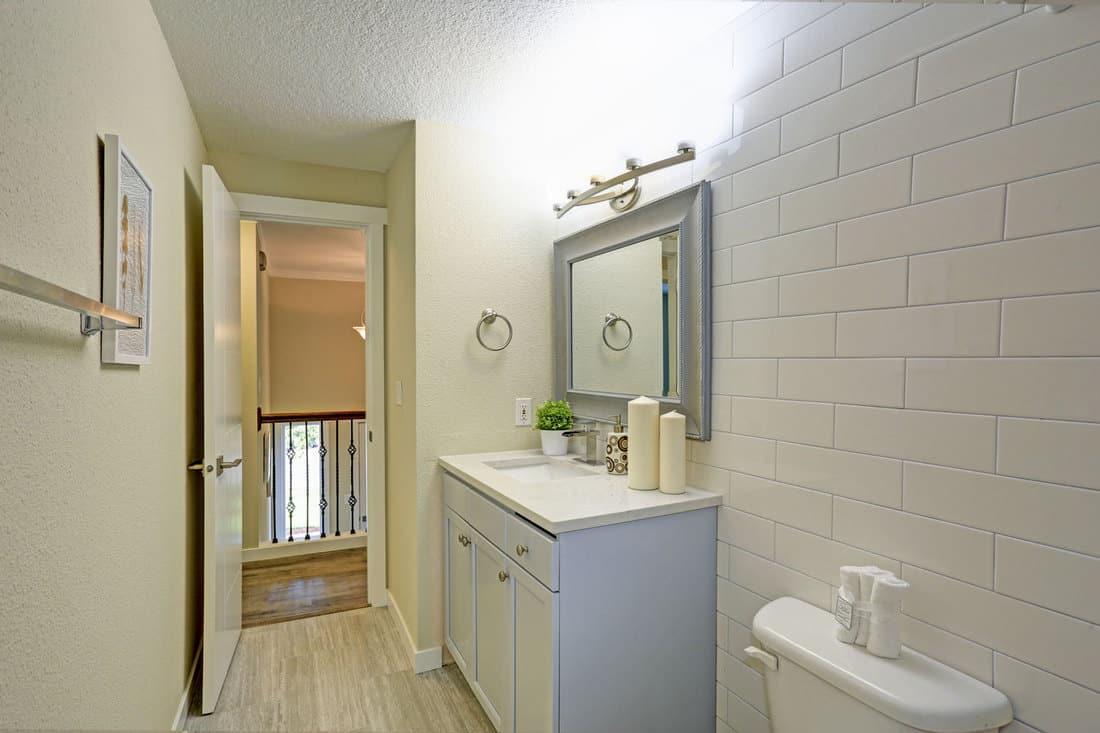 Freshly renovated bathroom features light blue bathroom vanity