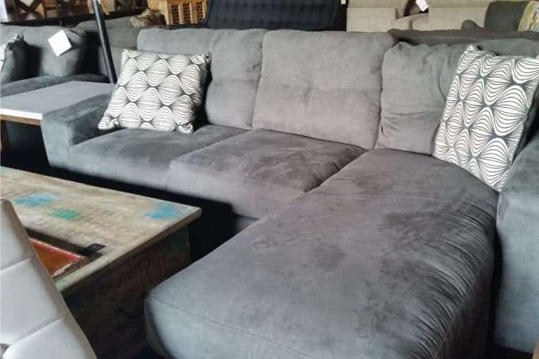 Gray silver sectional sofa with chaise furniture with accent pillows, Where To Place A Sectional In Your Living Room (Inc. Should It Be Against A Wall)?