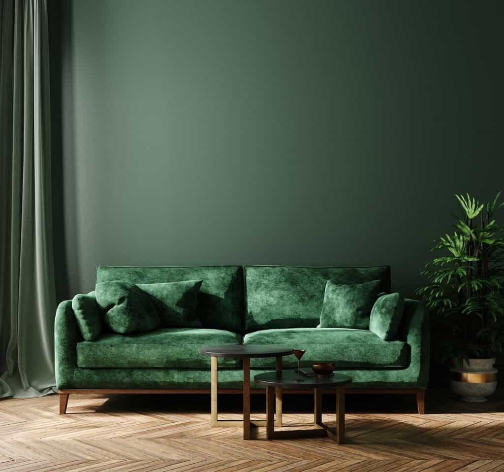 Home interior mock-up with green sofa, table and decor in living room