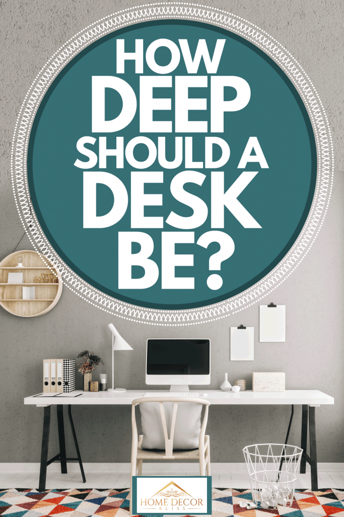Scandinavian styled home office with a Mac computer on the table and colored rug on the table, How Deep Should A Desk Be?