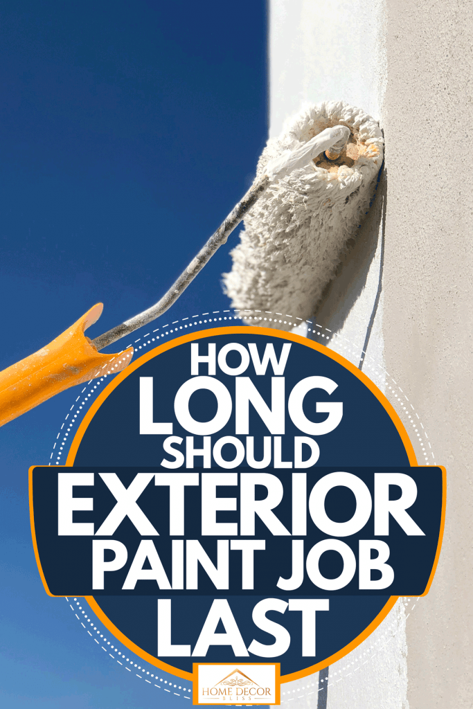 A painted using a roller to paint the exterior wall with white stucco paint, How Long Should Exterior Paint Job Last