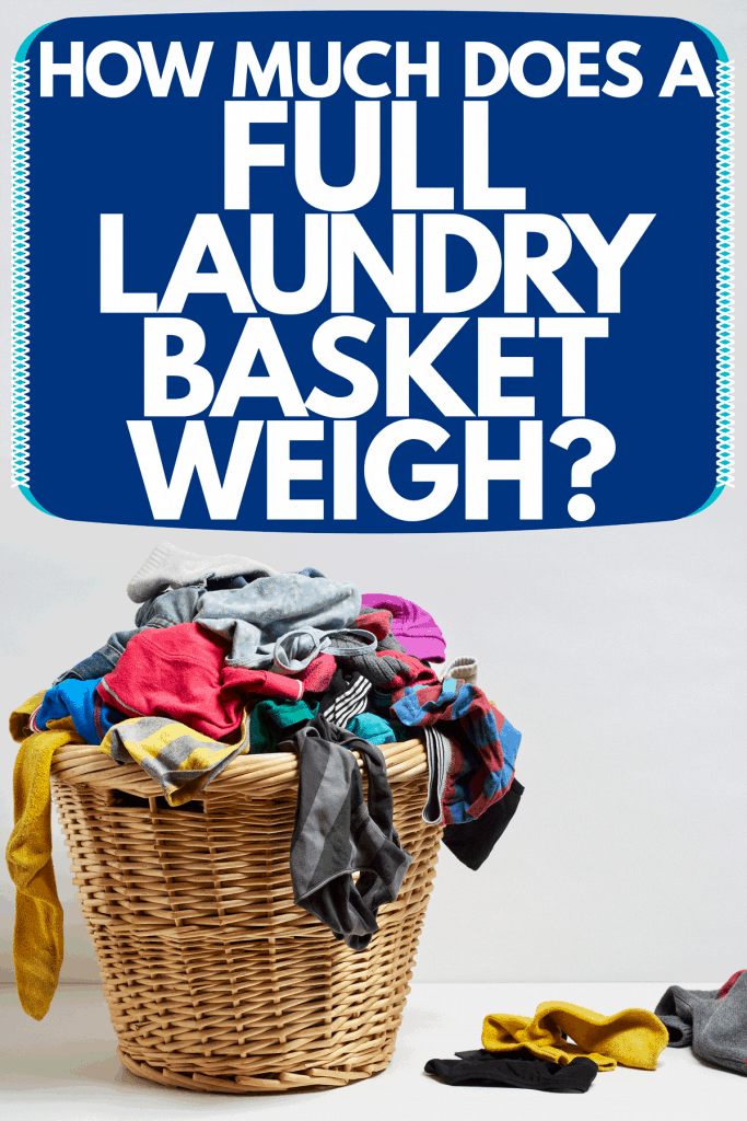 A laundry basket filled with laundry placed on a gray background, How Much Does A Full Laundry Basket Weigh?