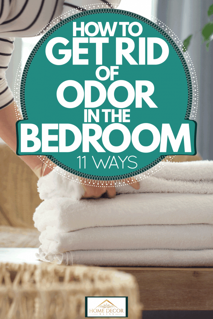 A woman folding newly cleaned laundry in her bedroom, How to Get Rid of Odor in the Bedroom [11 Ways]