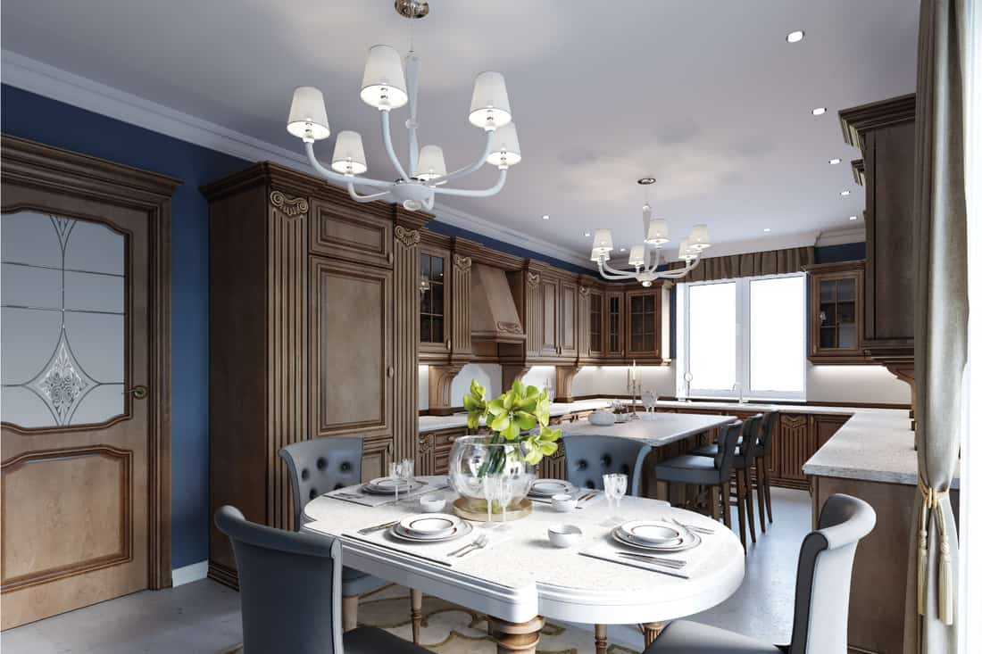 Kitchen and dining in luxury home with cherry wood cabinets and blue wall panels