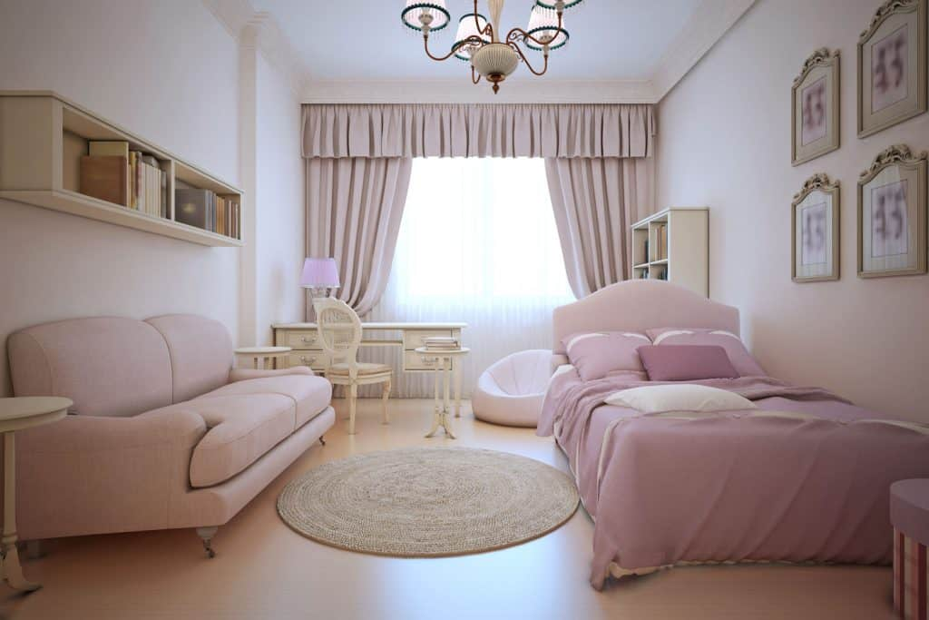 Ladies bedroom with light pink beddings, sofas, curtains inside a white painted bedroom
