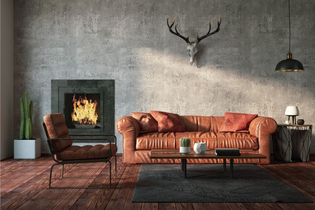 Loft Interior with brown Leather Sofa and dark wood floors