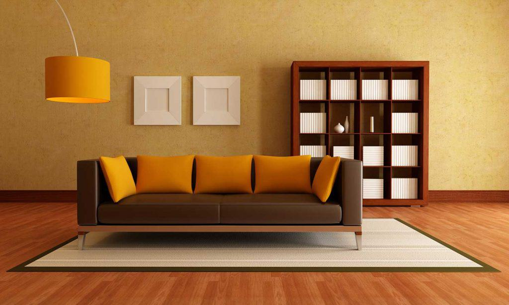 Modern elegant living room with brown sofa and yellow throw pillows