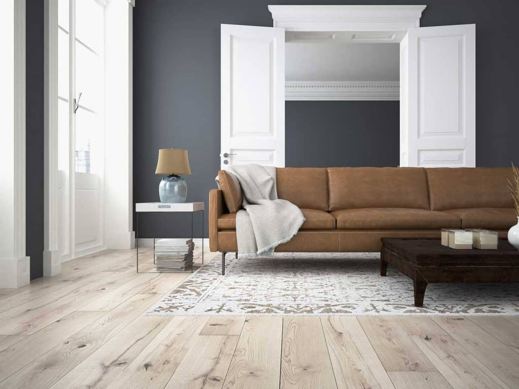 Modern living room with brown sofa and wooden floor