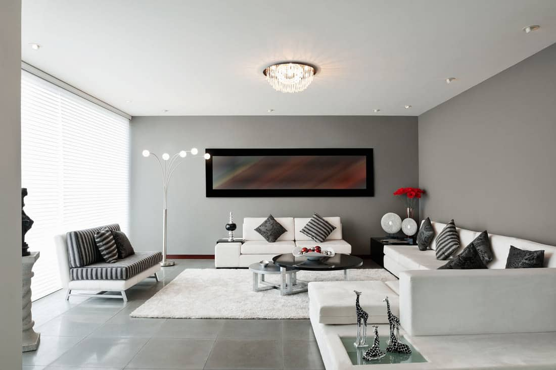 modern living room with white couches and sriped throw pillows