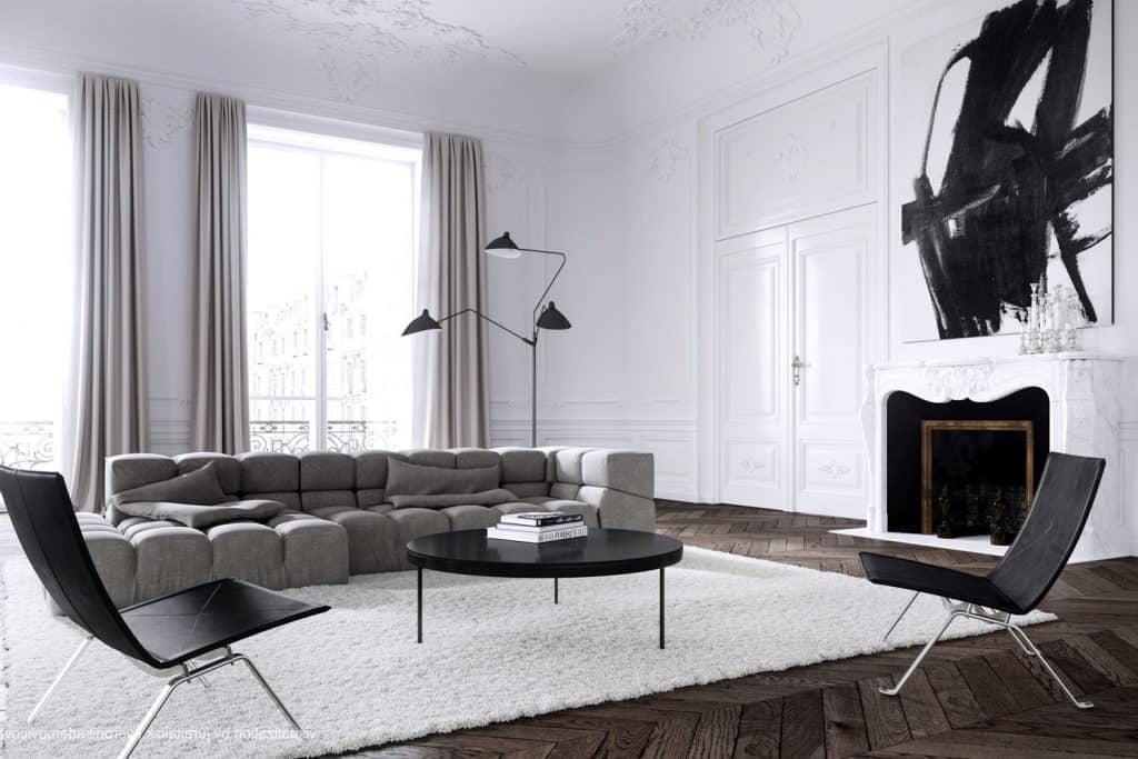 Modern living room with white walls combined with retro styled sofas, chairs and gray wooden flooring