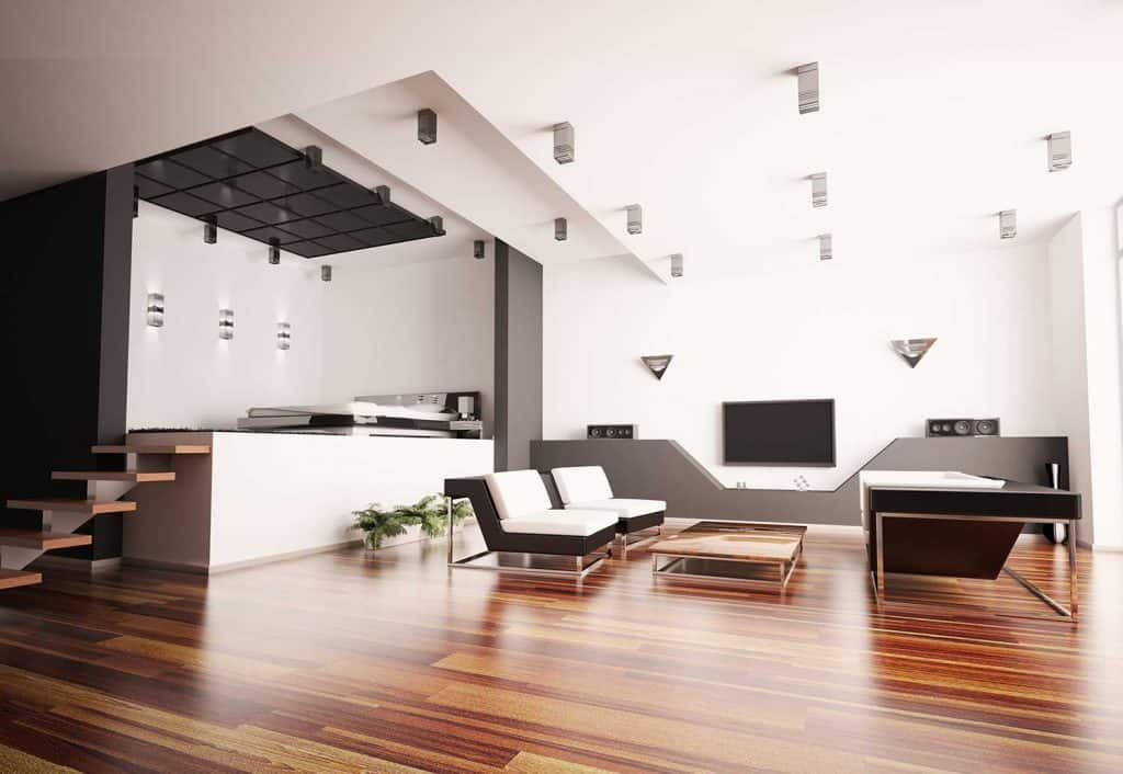 Modern loft apartment interior with parquet floor and TV hanging on white walls