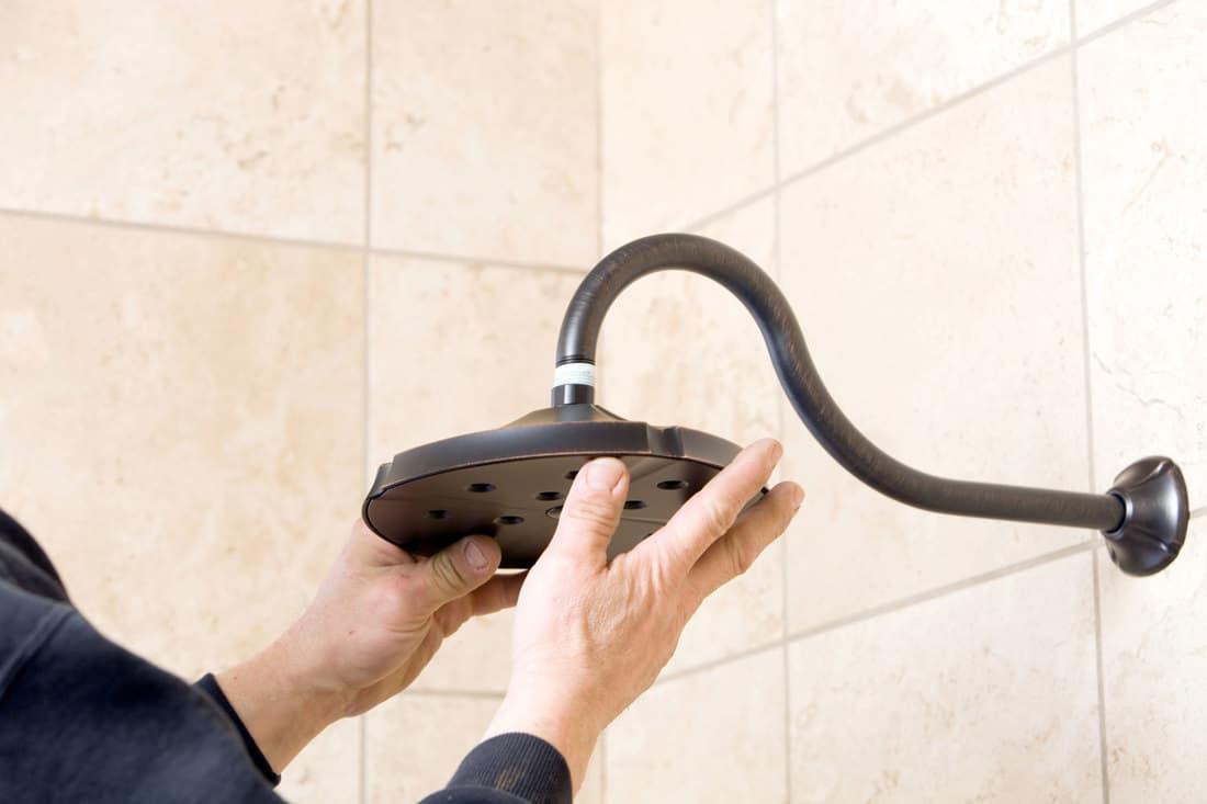 Plumber Installing New Showerhead