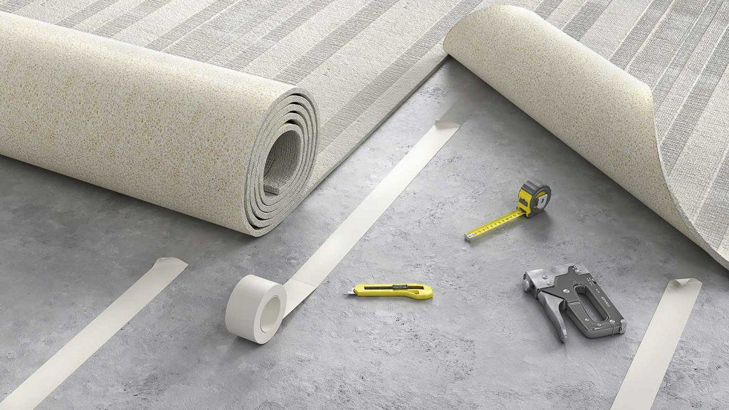 Process of laying cozy beige carpet on floor