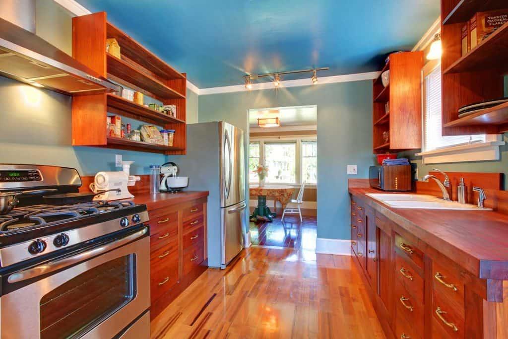 Shiny custom build kitchen with cherry wood