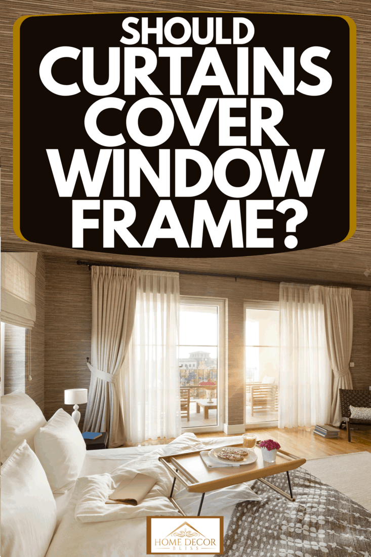 A beautiful rustic themed living room with a huge window with white drapes and cream colored curtains, Should Curtains Cover Window Frame?
