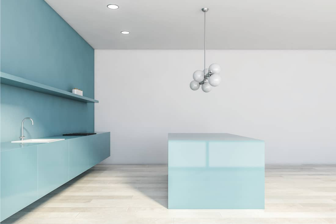Side view of white and blue kitchen with island