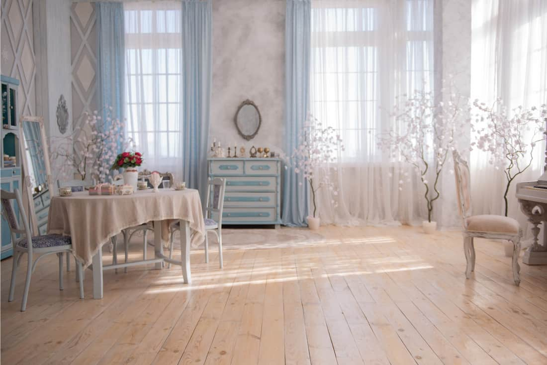 The interior in the vintage style with a table in blue tones