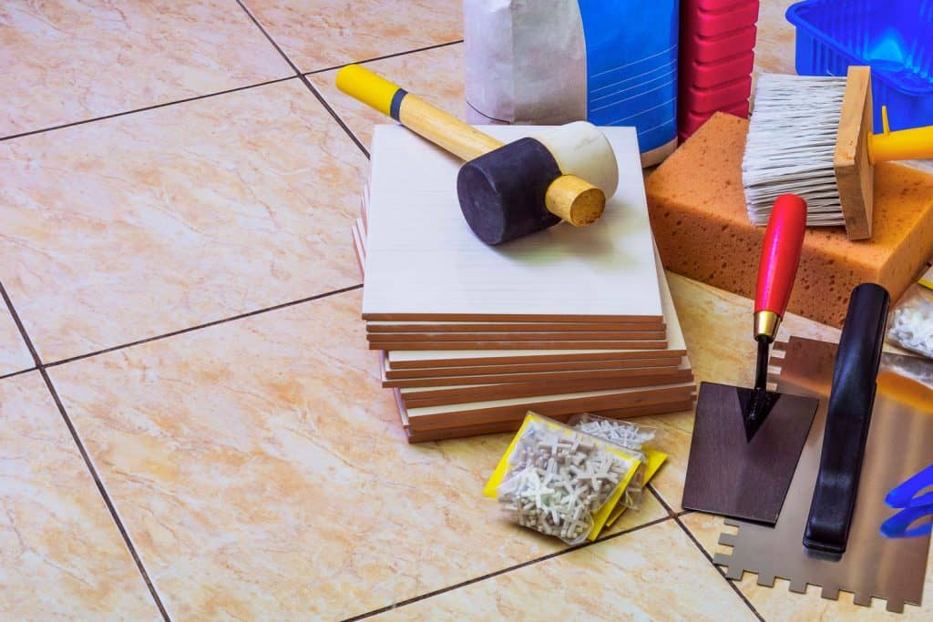 Tile setting materials placed on the side of a bathroom
