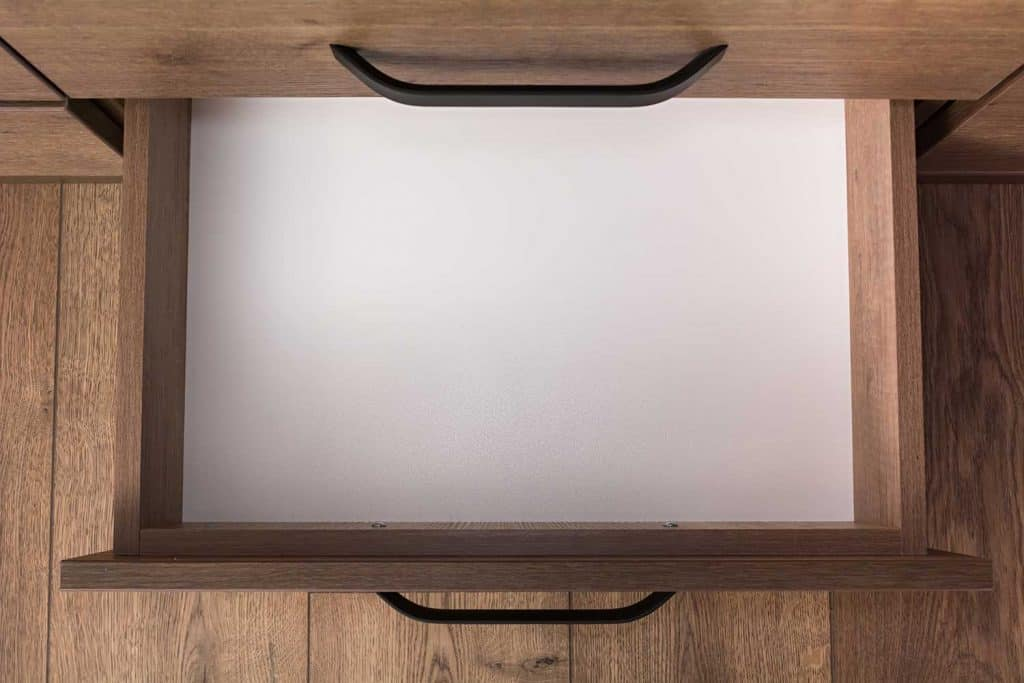 Top view of empty open wooden drawer