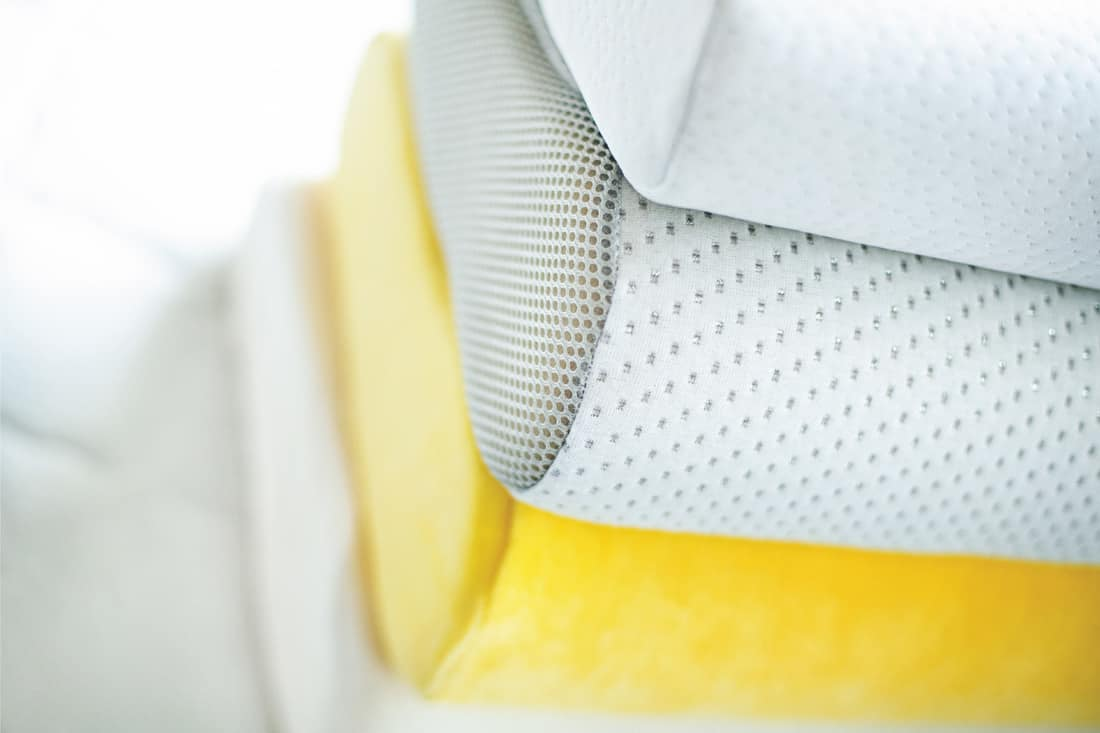 Top view of stack of soft and comfortable pillows on a bed mattress