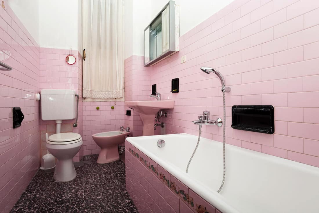 Traditional home with pink bathroom