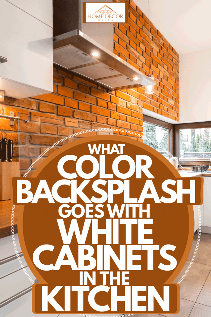A modern kitchen with a brick backsplash incorporated with a wooden countertop, What Color Backsplash Goes With White Cabinets in the Kitchen