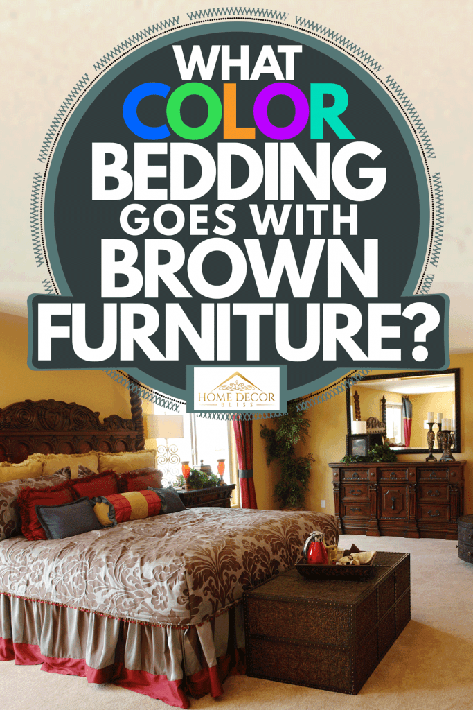 Country designed bedroom with carpeted flooring, brown furniture's, red accent chairs, and floral beddings with red throw pillows, What Color Bedding Goes With Brown Furniture?