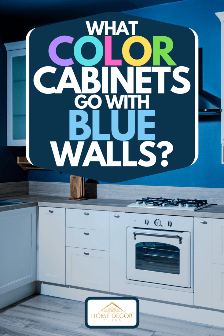 An interior of contemporary wooden kitchen with white furniture and blue walls, What Color Cabinets Go With Blue Walls?