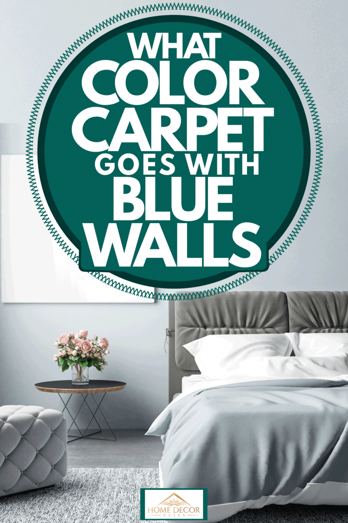 A blue walled living room with a white canvas hanged on the wall and a bed with gray and white beddings, What Color Carpet Goes With Blue Walls, What Color Carpet Goes With Blue Walls